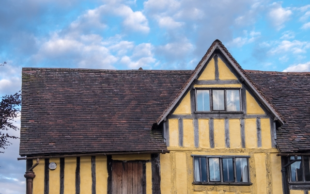 Half-timbered building, brightly coloured.